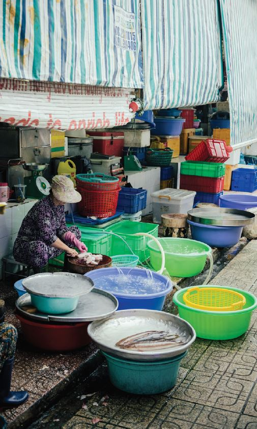 Woman surrounded by buckets of water