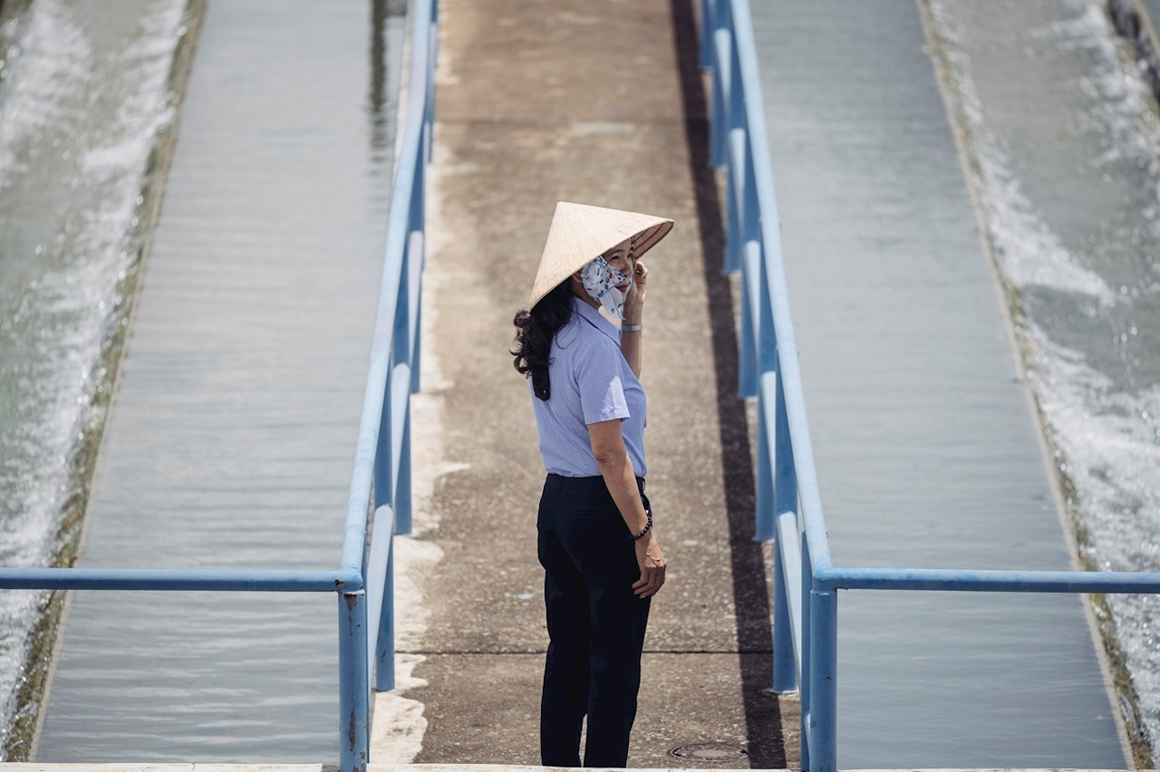 Woman standing at a water plant