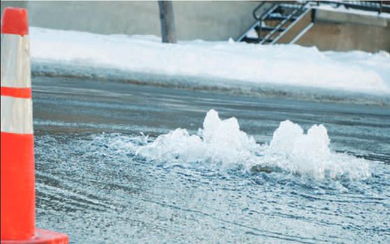 Water overflowing on street